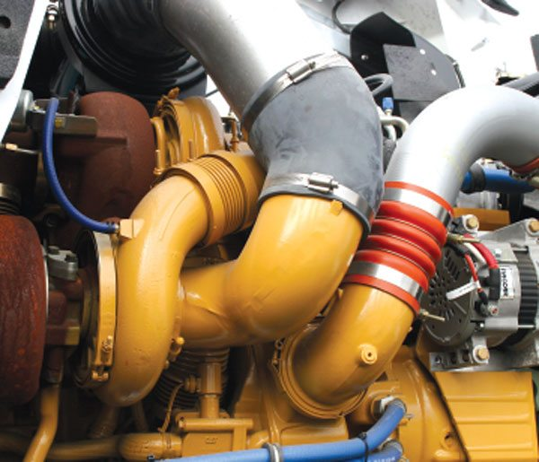 This C15 Caterpillar engine is popular among many line-haul fleets and owner-operators requiring high horsepower. This 15-liter engine uses a compound turbo setup, which is commonly, but incorrectly, called a twin-turbo system. Twins are two identical turbos where each turbo is matched to flow one-half of the engine's air-mass demand and each turbo feeds the engine directly. In a compound turbo system, one turbo feeds the next for a compound effect to create a second stage of compression. The engine comes in ratings ranging from 435 hp with 1,550 ft-lbs of torque to 625 hp with 2,050 ft-lbs of torque. While these ratings may not sound astonishingly grand to high-horsepower enthusiasts, the engineering feat is that these commercial engines can produce this output all day long, and not require engine rebuilding for 500,000 to 1,000,000 miles!