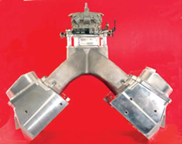 Fig. 4.12. Having a more direct line of approach to the port in the cylinder head from the manifold runner almost always helps sort out and improve wet flow. This 18-degree-style small-block Chevy head has manifold runners that, from this view, align directly with the ports. This is not so on many heads, such as the stock-style 23-degree heads.