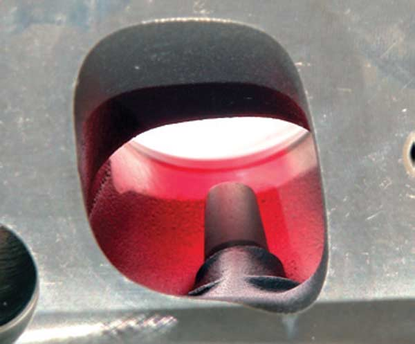 Fig. 5.19. I highlighted the port bowl in red so the white background stands out. You can see that a fair portion of the back of the intake valve on this TFS head would be visible. On the stock heads, none of the valve is even close to being visible.