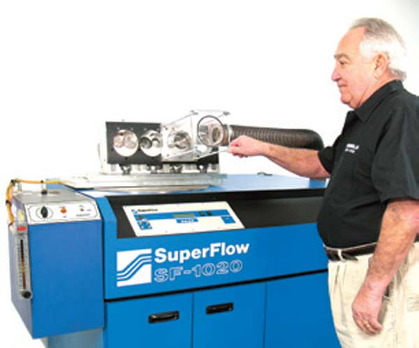 Fig. 4.2. Seen here is the late Joe Mondello showing off his wet-flow attachment for a conventional Super Flow bench. This add-on is available for most of the commercially available race shop benches on the market.