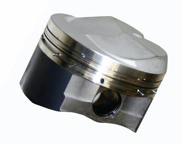 Domed pistons raise compression by displacing volume in the combustion space above the piston deck, but shallow combustion chambers are the current trend for raising compression ratio. By eliminating or reducing the dome, combustion efficiency is improved because the dome is not there to block the flame kernel that initiates at the spark plug.