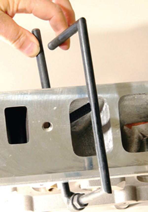 Fig. 6.10. The E-bar tool in use. The gap between the two bar components (arrow) indicates twice the thickness of material remaining.