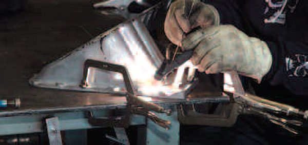 Tacking the piece into place at several points along the weld line helps avoid warping the part. If you weld solidly from one side to the other, the part will warp.