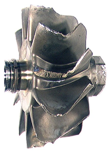 Turbine wheel overspeed will induce cyclic overstress and cause the turbine blades to fail. Note that the fracture started at the high-pressure side of the blade by the blue heat indicator. Once the turbine blade fragment broke loose it caused consequential damage to the inducer blade tips, giving it the look of an FOD failure. (Courtesy Honeywell Turbo Technologies)