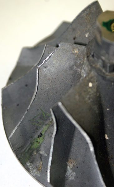 Compressor wheel blade fragment thrown off during an overspeed condition.