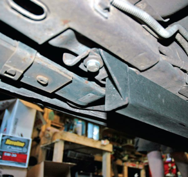 The rear attachment of this bolt-in subframe connector bolts to the forward perch of the rear leaf spring.