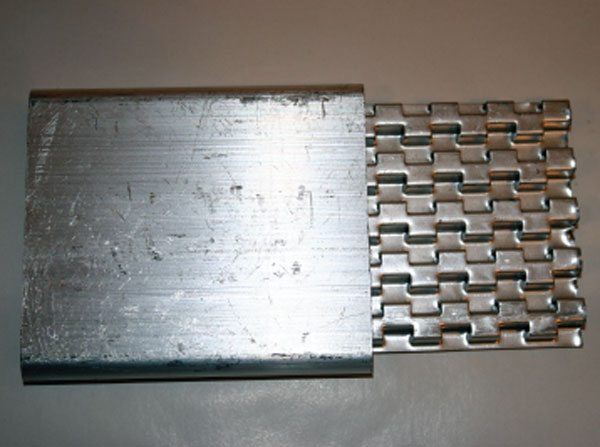 This is an aftercooler air tube from a tube and fin cooler with a row of turbulators shown. The turbulators section simply slides inside the air tube and breaks-up laminar flow while increasing the heat-sink capacity by providing more mass for the air to heat up. (Courtesy Diesel Injection Service Company, Inc.)