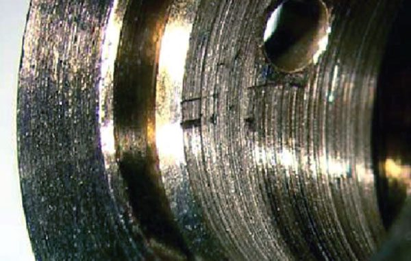 A close-up of the bearing ID shows the fine scoring that is associated with fine particles in lube oil from a dirty oil filter that has caused the filtration system to go into filter bypass mode to save the engine. A good magnifying glass is sometimes a very good tool to use when performing turbo failure analysis. This type of failure can be a warning sign that premature engine failure is close behind. (Courtesy Honeywell Turbo Technologies)
