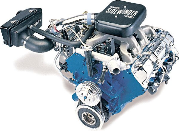 "This is the turbo diesel retrofit kit for the older GM 6.2-liter diesel engine. Gale Banks Engineering sold these by the thousands for GM pickup trucks and Suburbans. This kit played a major role in the development of the ""consumer diesel"" performance boom as the sport truck trend revved-up in the early '90s. The turbocharger used in this kit was a T04B25 model that used Banks' own end housings. Note the fact that this turbo system was not aftercooled. The compressor discharge boost tube runs directly to the intake plenum. The mild boost created by this system, 7 to 9 lbs., allowed the fuel setting on the injection pump to be legally stepped-up to match with the higher airflow. Once completed, the turbocharged 6.2-liter engine, which was normally a slug in the performance category, drove like it was a big-block 454 gas engine, but got diesel fuel economy! (Courtesy Gale Banks Engineering)"
