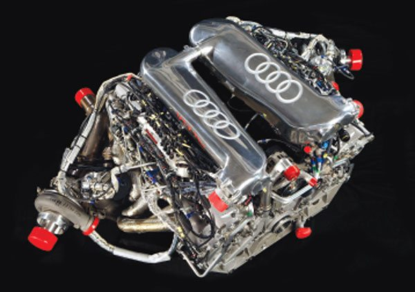 The engine in the Audi R10 TDI is a 336-ci DOHC 90-degree V-12 that develops over 650 hp and 800 ft-lbs of torque. The fuel system is a Bosch High-Pressure Common Rail with piezo injectors, and the intake is pressurized by twin Garrett TR30R Turbochargers. (Courtesy Audi)
