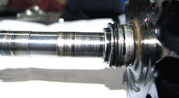 The turbine shaft will typically show signs of wear, although in some cases not near as severely as is shown here. In this case, both the turbine and compressor ends are scored further signifying contaminated lube oil. The bearings will show wear first due to their softer material. Usually in failures of this type there will not be any sign of high heat such as a straw or blue discoloration. (Courtesy Honeywell Turbo Technologies)