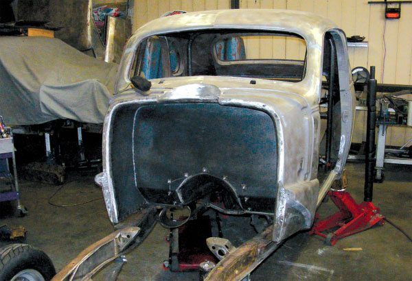 A vintage car like this one, being built up into a period-correct gasser drag racer, will take some serious chassis work before it can handle the forces of a modern racing engine.