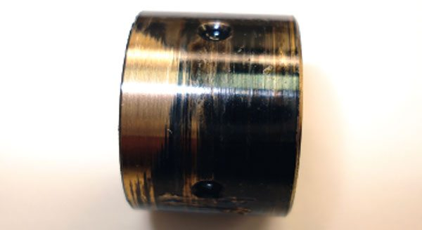 The heat discoloration will be evident in the bearings as well as the shaft. In severe cases, the bearings may be gelded onto the shaft where the disassembly process required force to remove the turbine shaft from the bearing housing. (Courtesy Honeywell Turbo Technologies)