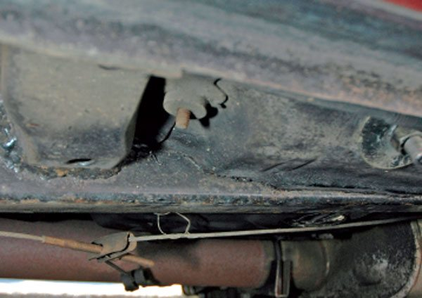 The subframe connector viewed from underneath the car where it cuts through the floor. Note that where the crossmember was cut, it has been rewelded to the subframe connector.