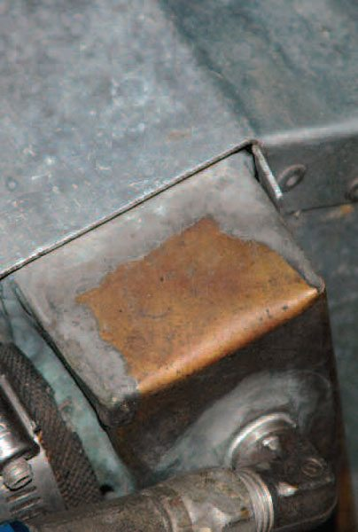This radiator tank is made of copper, with the seams brazed shut and AN fittings brazed onto the tank as well. It's lasted at least 20 years this way with no leaks.