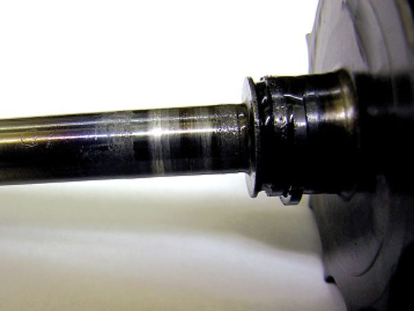 Hot shut down is a common cause of oil starvation or lack of lube. Oil cooked in the bearing housing will clog up the turbine end oil feed like cholesterol in your arteries and starve the bearings of lubricating oil. Note how the turbine end is more severely worn than the compressor end. (Courtesy Honeywell Turbo Technologies)