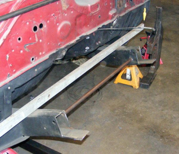 We cut the frame rails off, leaving plenty of supporting material to support the new structure when we weld it on.
