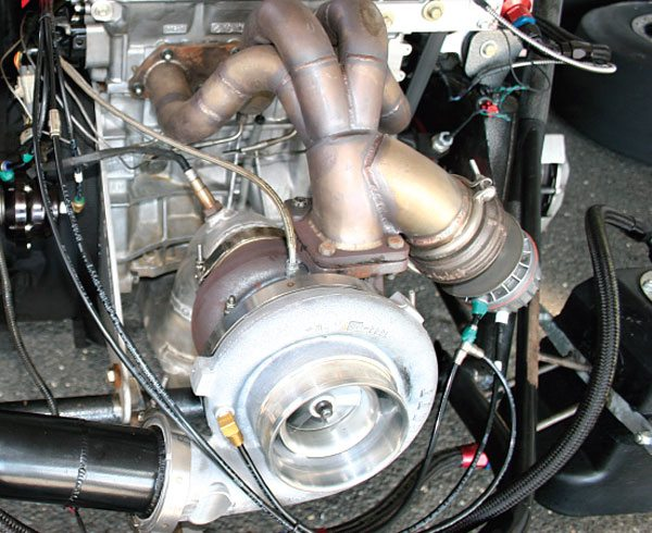 In a transverse engine, the arrangement of a 4-cylinder engine yields a lot of room for the turbo to be positioned front and center.
