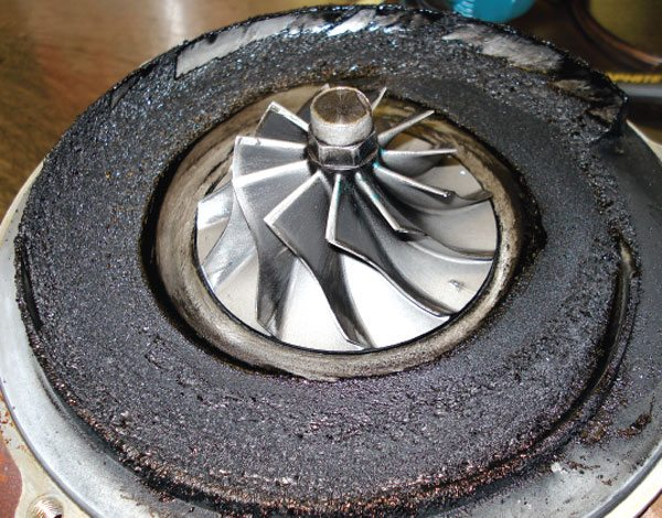 Compressors simply should not leak oil. Signs such as this are typically caused by outside influences such as a pressurized crankcase, or an improperly routed oil return line that enters the oil pan below the oil level, or a poorly run oil drain line that got kinked. (Courtesy Honeywell Turbo Technologies)