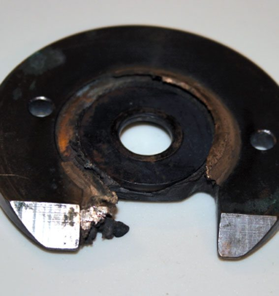 This failure was caused by a severe negative pressure differential. The pressure on the turbine end was so much greater than on the compressor that it literally pulled the thrust ring right through the thrust bearing and imbedded it into the center of the bronze.