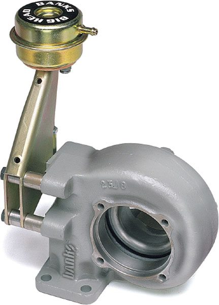 Banks' BigHead wastegate actuator and Quick Turbo turbine housing for Dodge-Cummins applications corrects a problem caused by the stock actuator's weak spring, which, under high-boost conditions, allows the wastegate to blow open, thereby limiting midrange torque. With twice the diaphragm area and spring pressure of the stock wastegate, BigHead keeps the valve seated longer for more precise control and raises peak boost up to 22 percent. Other manufacturers offer similar products to achieve this same goal. (Courtesy Gale Banks Engineering)