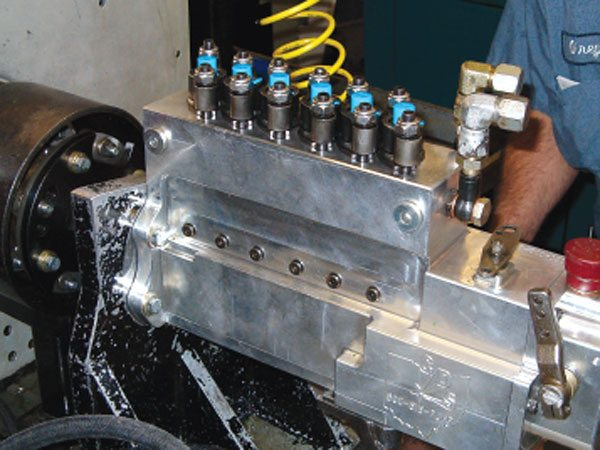 Columbus Diesel Supply builds a fuel injection pump from billet aluminum with 17mm plungers and barrels. Here, it's mounted on a specially modified 100-hp test stand. Depending upon the fuel settings, this pump can take up to 100 hp to run at track speed. (Courtesy Columbus Diesel Supply)