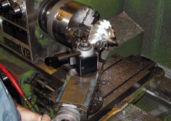 This compressor wheel is being machined to a 3-inch inducer to meet the Super Farm class criteria. In the Super Farm class the turbocharger's compressor wheel inducer is limited in size, thereby placing a horsepower limit on the entire class. Optimizing a turbocharger match for maximum power where the inducer size is restricted becomes very challenging and drives research to optimize wheel diameter, tip height, diffuser width, etc. (Courtesy Columbus Diesel Supply)