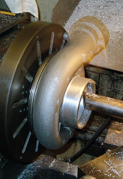 This compressor cover designed by Columbus Diesel Supply is being machined for a larger compressor wheel. This is the compressor matched to the turbine that is also enlarged (ref. to page 60) for the Pro Stock class. In order to maintain proper pressure and flow balance, both the turbine and compressor ends must be modified to properly accommodate the increased mass flow. (Courtesy Columbus Diesel Supply)