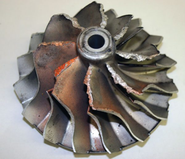 Note the even damage around the inducer area and the metal wiped and shredded from the repeated impact of a foreign object. (Courtesy Honeywell Turbo Technologies)