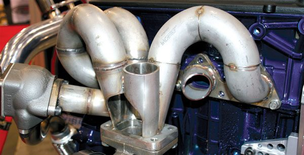 A complete tubular exhaust manifold can be constructed with cutting bends, tubing sections, and using ready made flanges from companies such as Vibrant Performance and Turbonetics. (Courtesy Vibrant Performance)