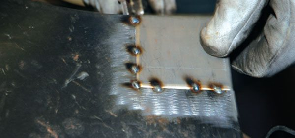 As always, tack your work into place before you commit any welding beads. Remember, this is sheetmetal, so use low power and let the work cool between stitches.