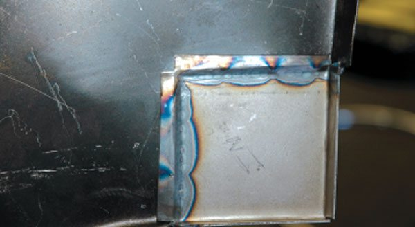 Here you can see the stitches Russ made, and you can see the excellent penetration of the weld into the recessed tabs we made. This is a solid weld that will hold up under bodyworking.