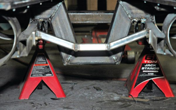 This structure serves as an additional crossmember support, as well as the required driveshaft support and mounting point for exhaust supports.