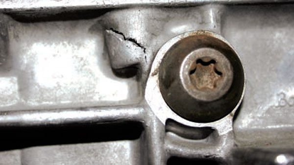 Too much sealant can get lodged in the housing bolt bores. When you screw in the bolts, hydraulic action may blow the case apart, especially if you use air tools.