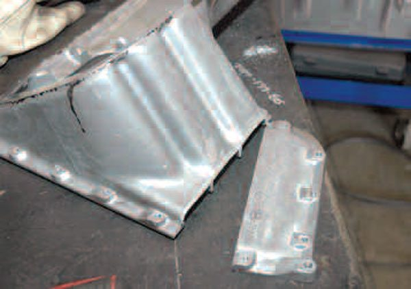 The two parts of the upper oil pan are cleaned, filed, and ready to weld.