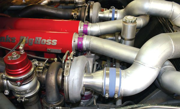 The Banks twin-turbo 6.6 liter Duramax diesel road race truck uses a frontal air intake to maximize the cool, dense air from in front of the heat exchangers. Note how the intake tubes are an extremely large 6-inch diameter that only neck down once they're within 12 inches of the compressor inducer. (Courtesy Gale Banks Engineering)