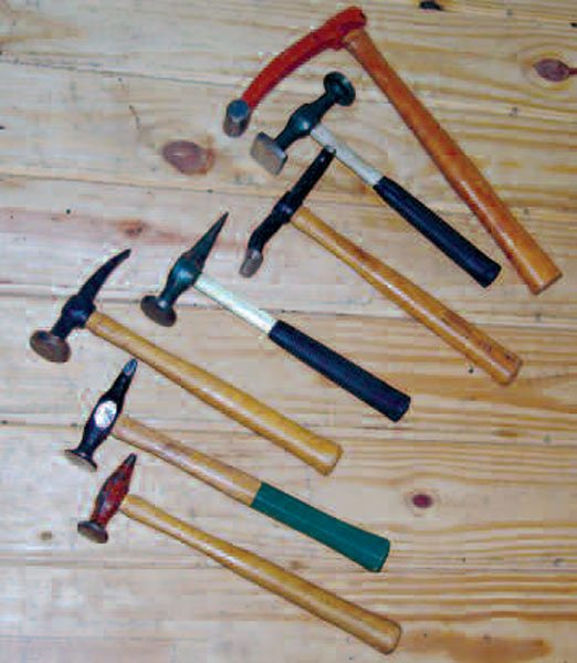 The first four tools (from the bottom up) are general-purpose combination body hammers, in various crowns. The fifth is a door-skinning hammer. The sixth is a low-crown hammer, with both round and square faces (the latter is for working up to flat edges). The seventh tool is a hammer for fender dinging.