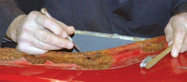 The first step in any rust repair job is to determine the extent of the damage. Picking and wire brushing are good ways to separate the sound metal from the weak metal.