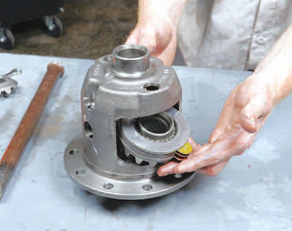 Once the pinions are out of the differential, the side gears can be removed as well. Carefully remove the clutch pack and shims with each side gear. Note that the last shim tends to stick in the housing, from the lube film.