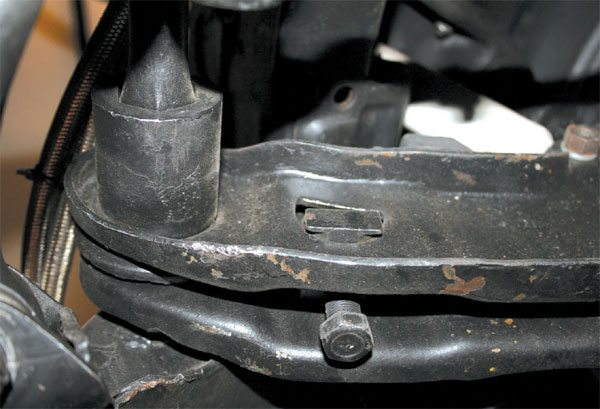 Here's a close-up look at the torsion bar adjuster bolt. This is typical for all Chrysler vehicles made between 1957 and 1980.