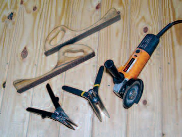 Many small and relatively inexpensive tools, like these body files, sheet-metal pliers, and 41⁄2-inch electric grinder, are endlessly handy for autobody metal work.