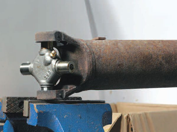 The first and easiest step during installation of a new joint is to place the journal cross between the yoke ears without the caps.