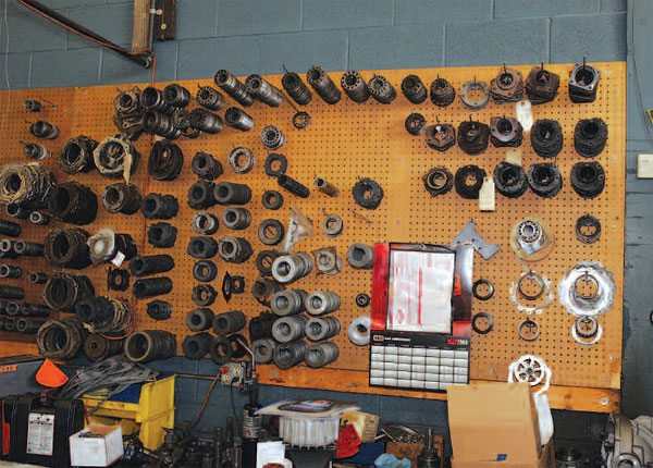 """As you look around for a shop, the facility does not have to be spotless in order to be reputable. Busy shops work through a lot of drivelines, so many are not """"operating room"""" clean. Here is a great selection of hard-to-find parts. Every good axle shop should have this available. (Randall Shafer)"""