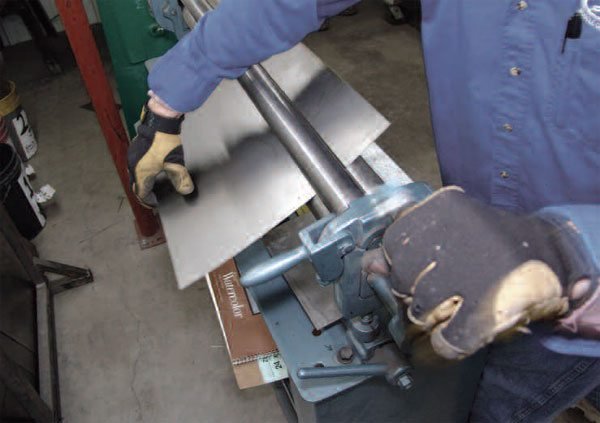 Slip rolls, like this hand-operated machine, provide for uniformly bending metal in one plane. They impart predictable and continuous curves to sheet-metal. Slip rolls can also be set to put several different curvatures in the same panel, and to flatten distorted metal.
