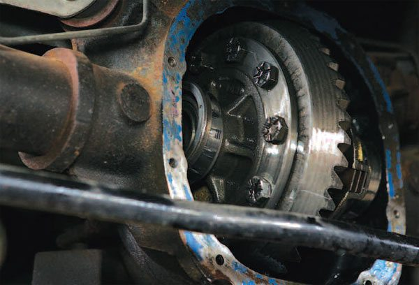 The differential case bearings are preloaded, and therefore installed with an interference fit, so they can be difficult to remove and install. The beveled edge of the shim is installed toward the axle housing. You want to have the full surface against the bearing cone. (Randall Shafer)