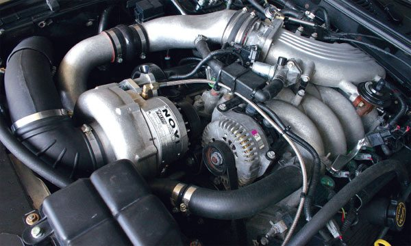 This engine is equipped with a Paxton centrifugal supercharger. A longer accessory drive belt is used to accommodate the extra pulleys and positioning.(Nate Tovey)