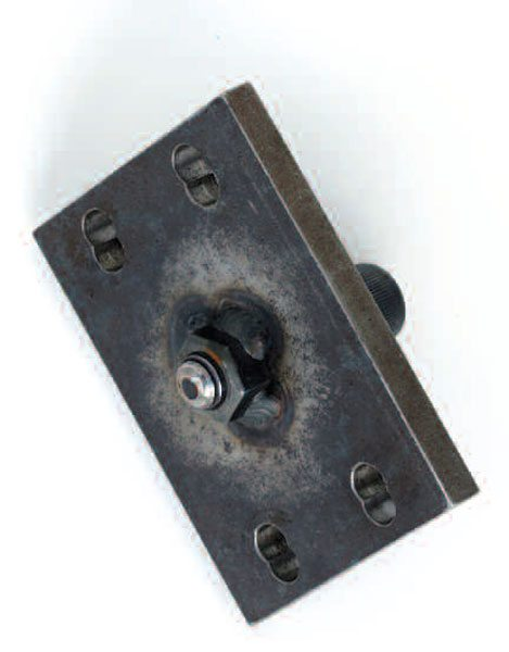 Since the pinion spline typically has a slight helix, the flanges may require a puller to remove them. You can fabricate this tool for the GM half-round-style pinion flange. It is a 3 x 4-inch piece of steel stock with the bolt pattern drilled in and nut welded in the center. This unit has a dual pattern for multiple-size U-joints.