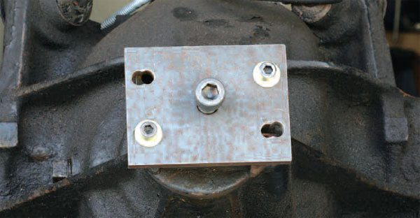 Depending on the flange type, you may be able to use a traditional jaw-style puller. The GM half-round requires a tool that bolts to flange, and the center bolt actually extracts the flange. This tool uses the same working principle as a harmonic balancer remover for an engine.