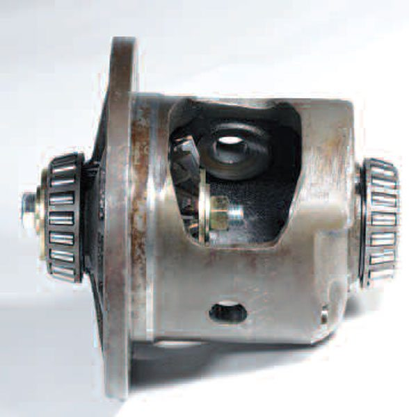 The nut and bolt with large washers provide an assembly aid. While typically not required, it can be helpful. Once the pinions are installed, you can remove this nut, bolt, and washer arrangement.