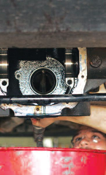 You need a long punch and hammer to drive the pinion head bearing race out of the housing from the front of the axle. (Randall Shafer)